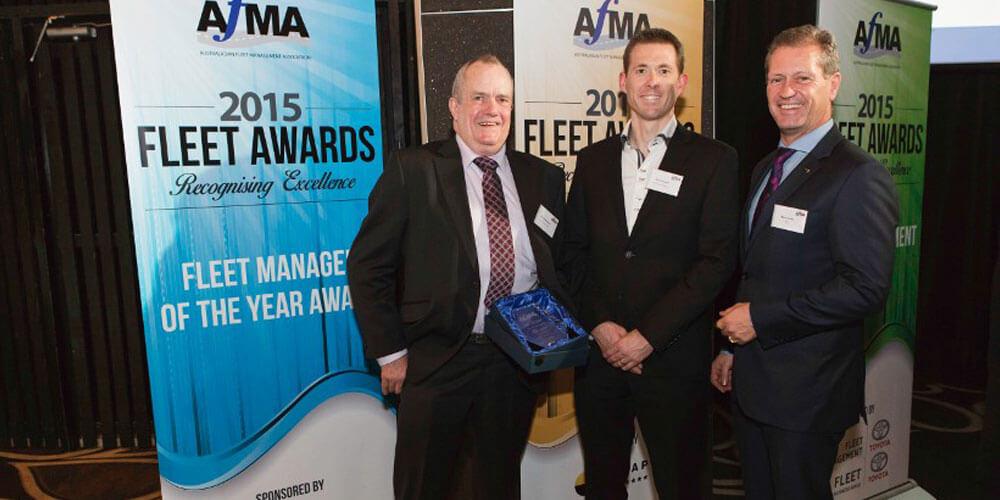 Well handled: David Stevenson (left) receives the top fleet manager award from AFMA executive director Mace Hartley (right) and sponsor Viva Energy Australia's Simon Stokes.