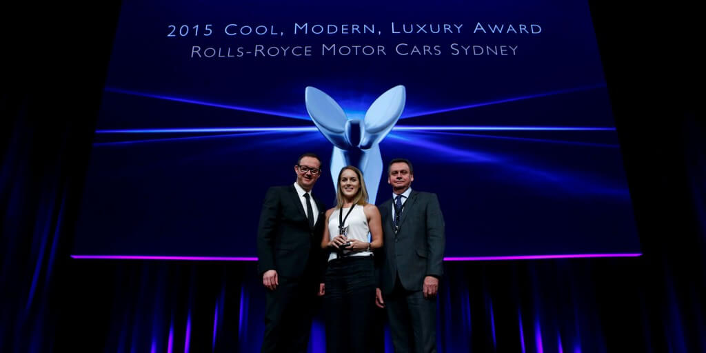 Spirit of Ecstasy: Rolls-Royce Motor Cars Sydney marketing manager Jemma White with dealer principal Marc Webb (right) and Rolls-Royce global marketing chief Marc Mielau at the awards presentation in Berlin.