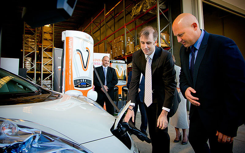 Charged up: Tritium CEO David Finn (left) shows Queensland treasurer Curtis Pitt the latest in fast-charging technology.