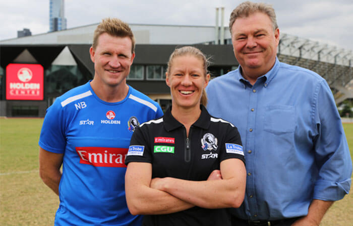 Holden on: Collingwood women's football operations manager Meg Hutchins (centre) with men's coach Nathan Buckley (left) and director of football Neil Balme.