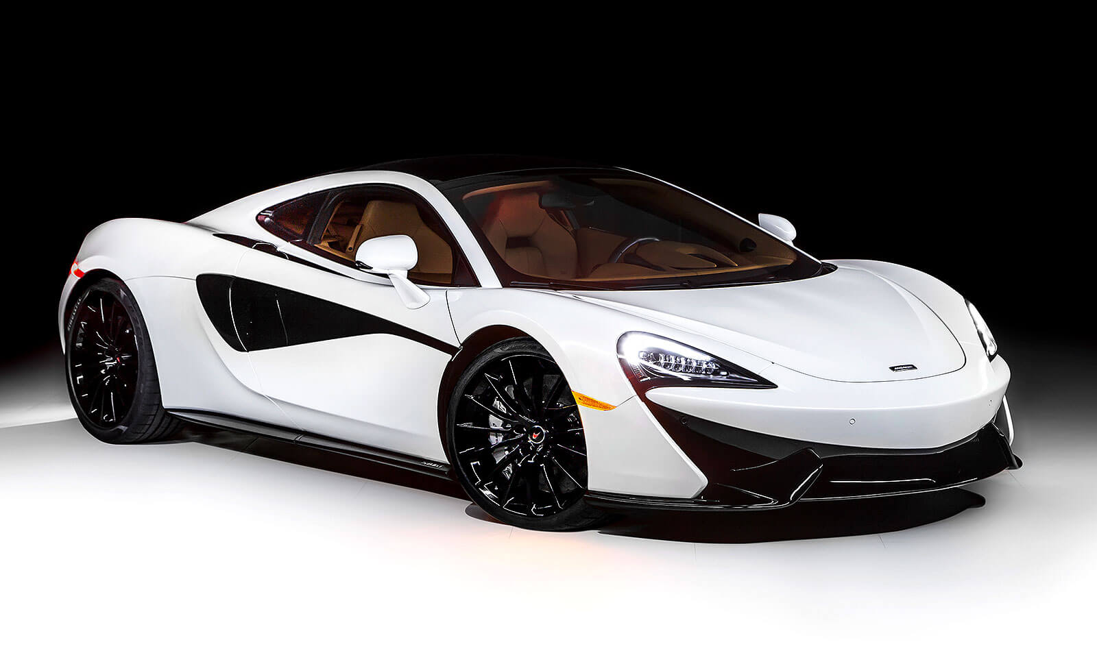 """Defining moment: The McLaren 570GT by MSO Concept made its debut on the 18th fairway of the Pebble Beach golf course in August, bearing """"styling, feature and material enhancements"""" that will all become available through the MSO Defined portfolio."""