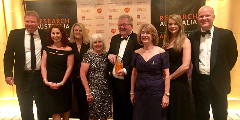 Award season: Volvo Car Australian managing director Kevin McCann (centre) accepts the Research Australian Leadership in Corporate Giving award for contributions made to the Cure Brain Cancer Foundation.